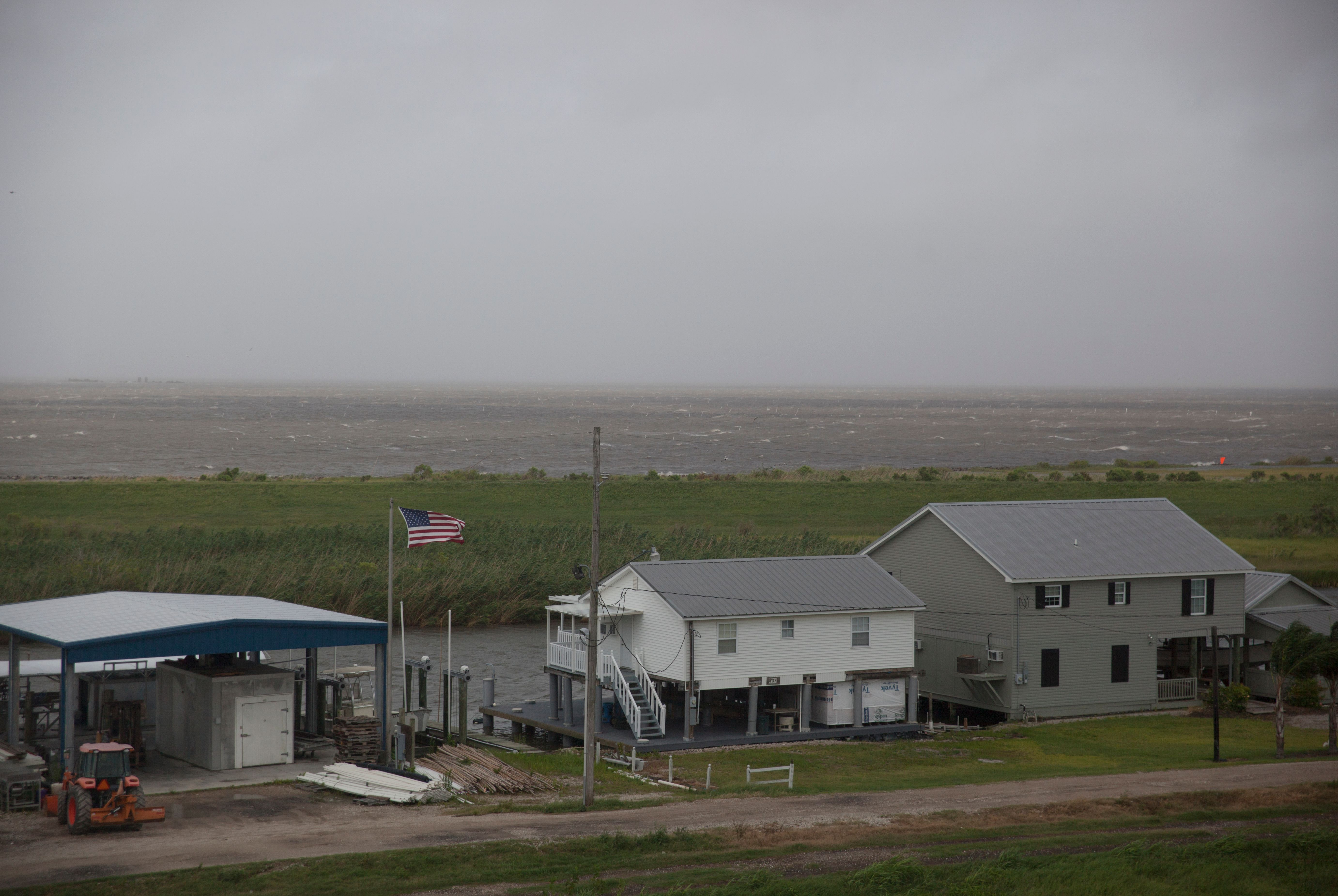 A US national flag flutters in high winds in Plaquemines Parish, Louisiana on July 12, 2019, ahead of the arrival of Tropical Storm Barry.