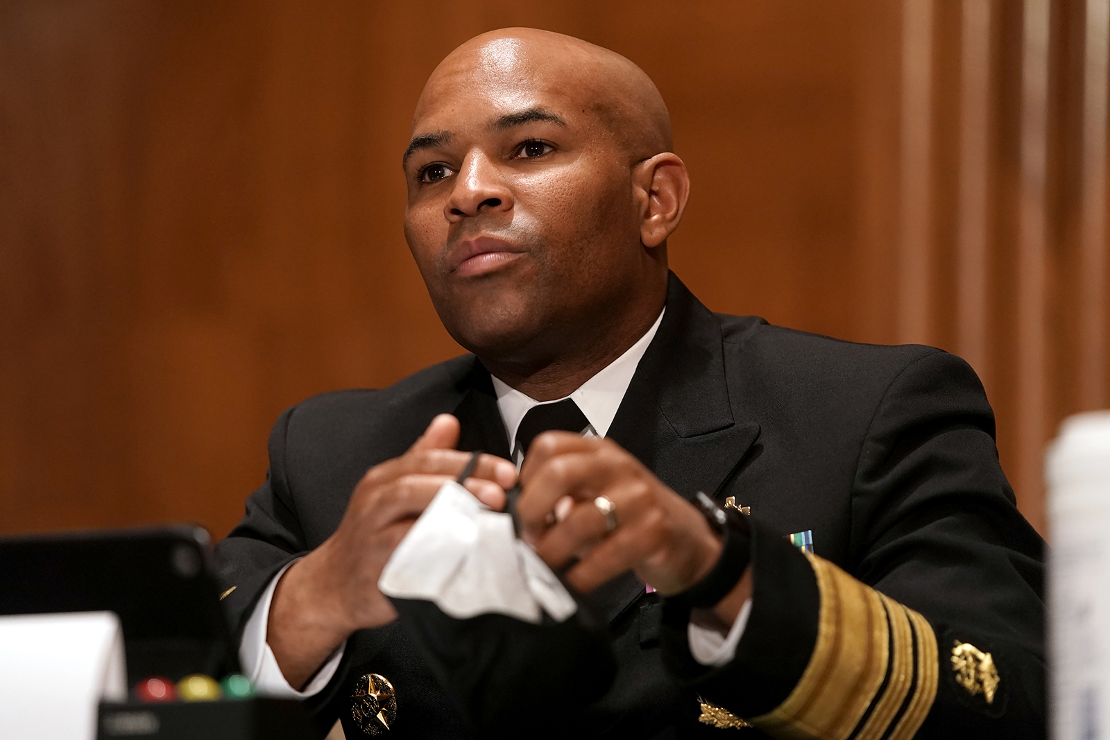 Surgeon General Jerome Adams takes his mask off to give his opening statement during a Senate Health, Education, Labor, and Pensions Committee hearing in Washington DC, on September 9.