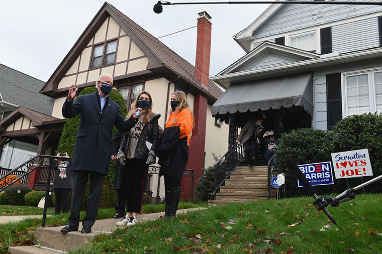 Democratic presidential candidate Joe Biden visits his childhood home with his granddaughters in Scranton, Pennsylvania on November 3, 2020.