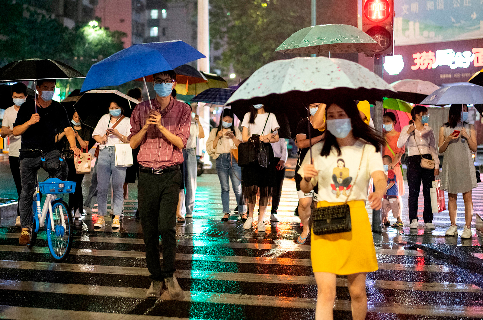 People wearing protective face masks walk in Shenzhen, China on May 22.