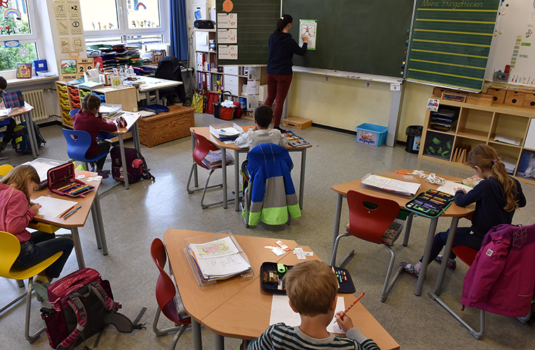 Students sit in a classroom at a primary school in Eichenau, Germany, on June 16.