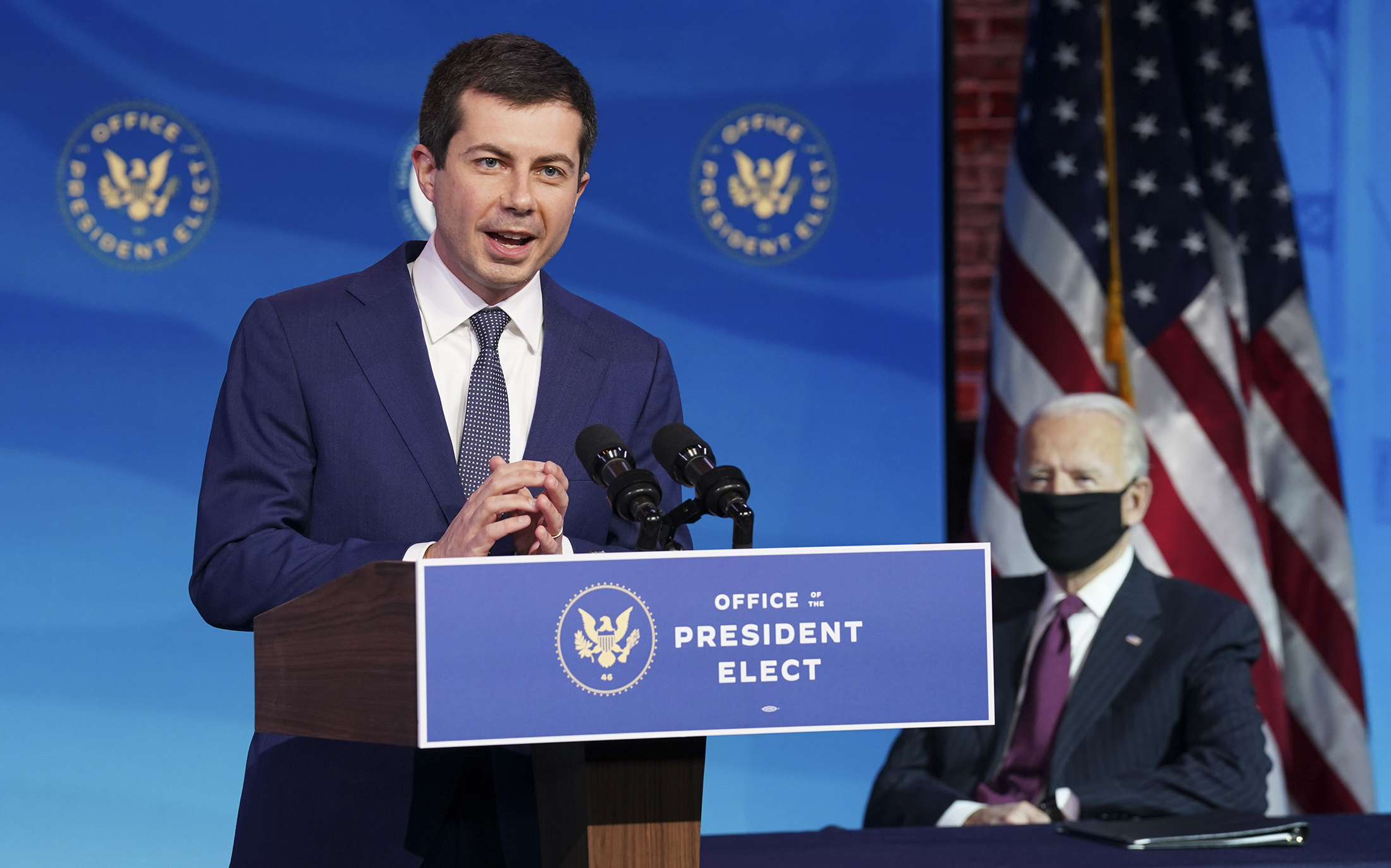 Pete Buttigieg, U.S. President-elect Joe Biden's nominee to be secretary of transportation, reacts to his nomination as Biden looks on during a news conference at Biden's transition headquarters in Wilmington, Delaware, on December 16.