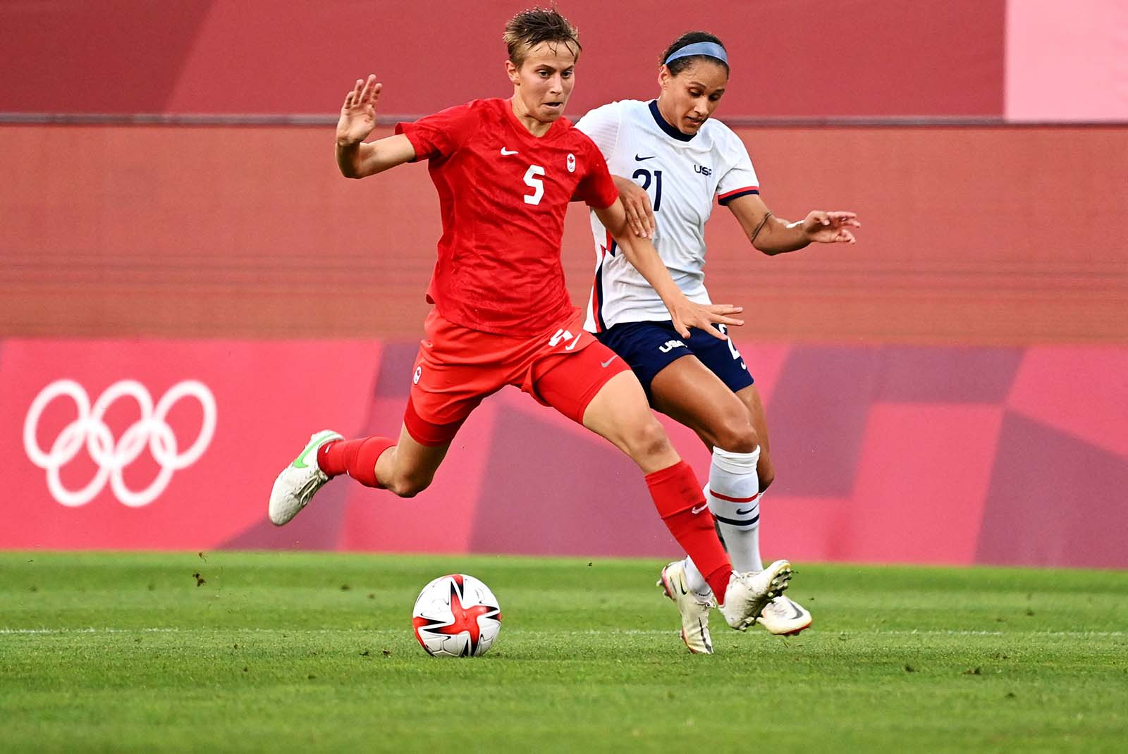 Canada's midfielder Quinn, left, is marked by the United States forward Lynn Williams during the women's semi-final soccer match on August 2.