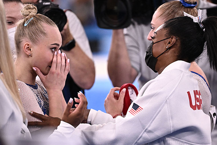 Russia's Angelina Melnikova, left, is congratulated by USA's Simone Biles as Russia wins the artistic gymnastics team final on July 27.