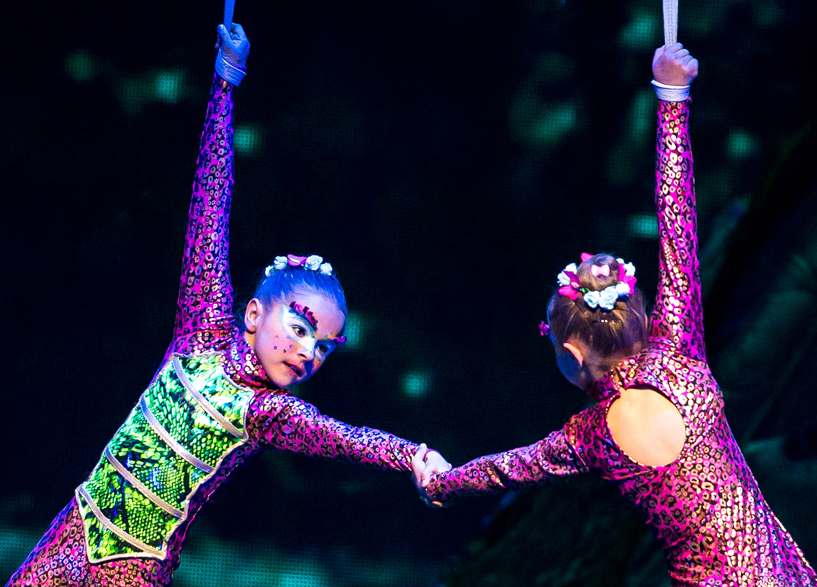 Performers hold hands in 'One Night For One Drop' by Cirque Du Soleil in Las Vegas, on March 18, 2016.
