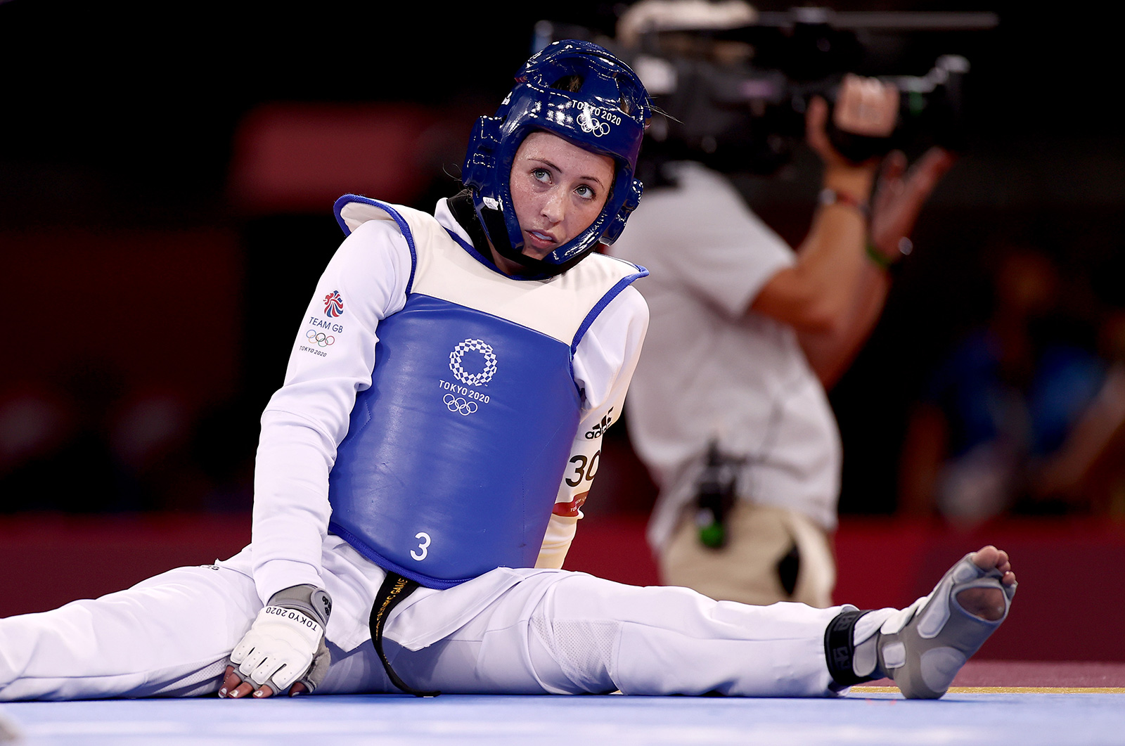 Jade Jones of Great Britain sits dejected after losing against Kimia Alizadeh Zonouzi of the IOC Refugee Team after a Taekwondo round on July 25.