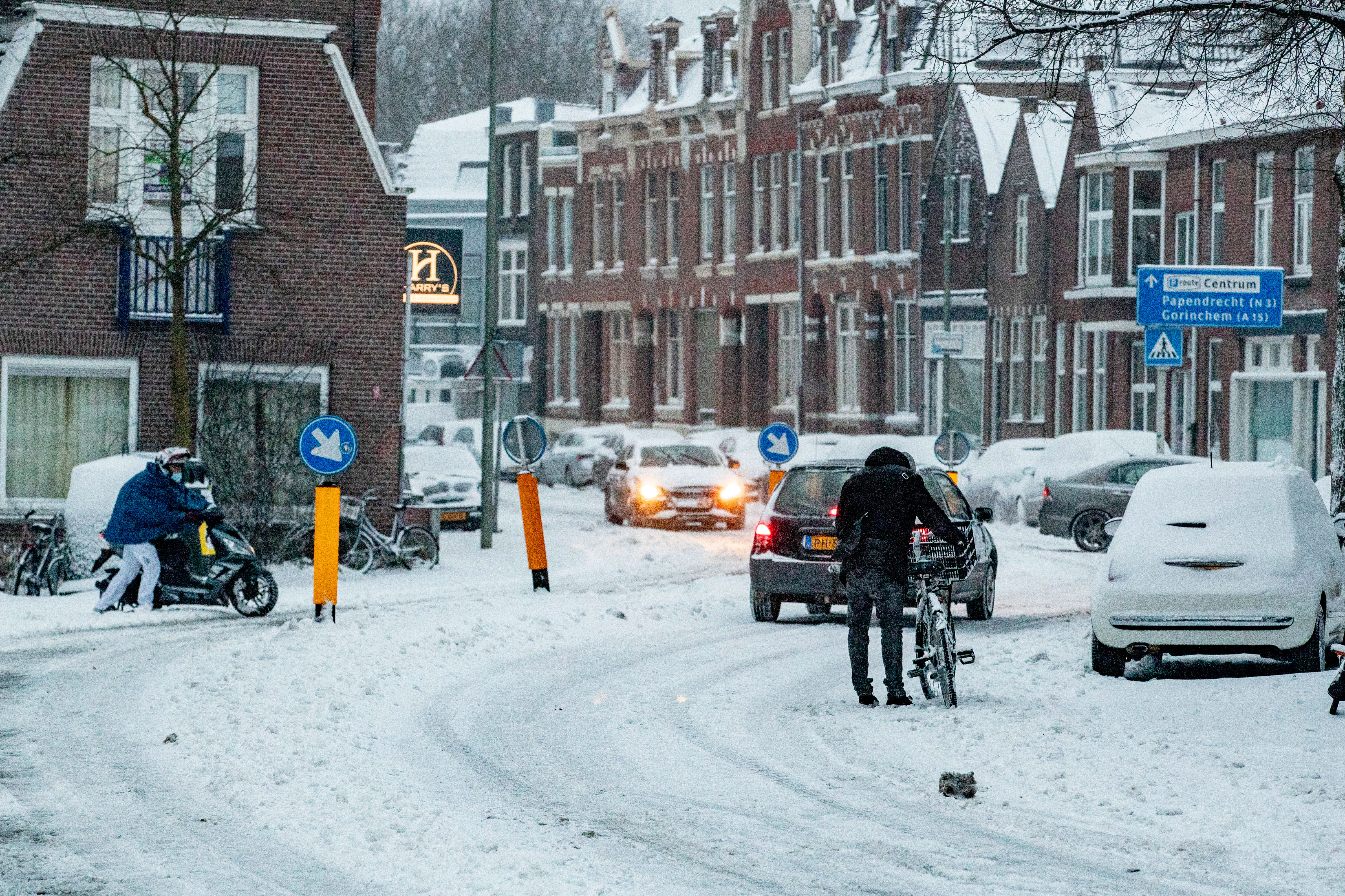 People travel in the snow on February 7 in Dordrecht, Netherlands.