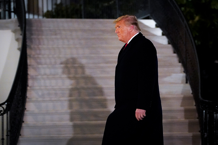 U.S. President Donald Trump walks to the White House residence after exiting Marine One upon his return on January 12, 2021 in Washington, DC.