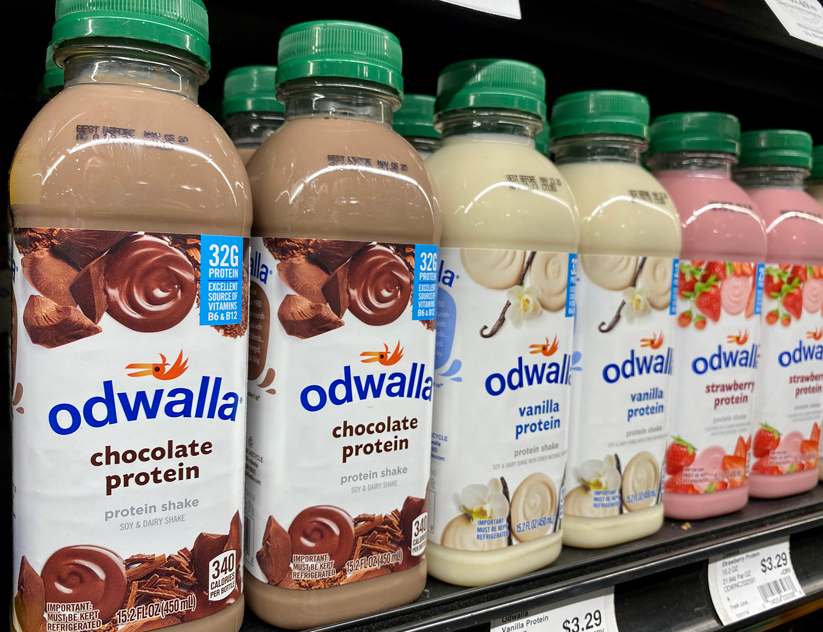 Bottles of Odwalla protein shakes sit on a grocery store shelf.