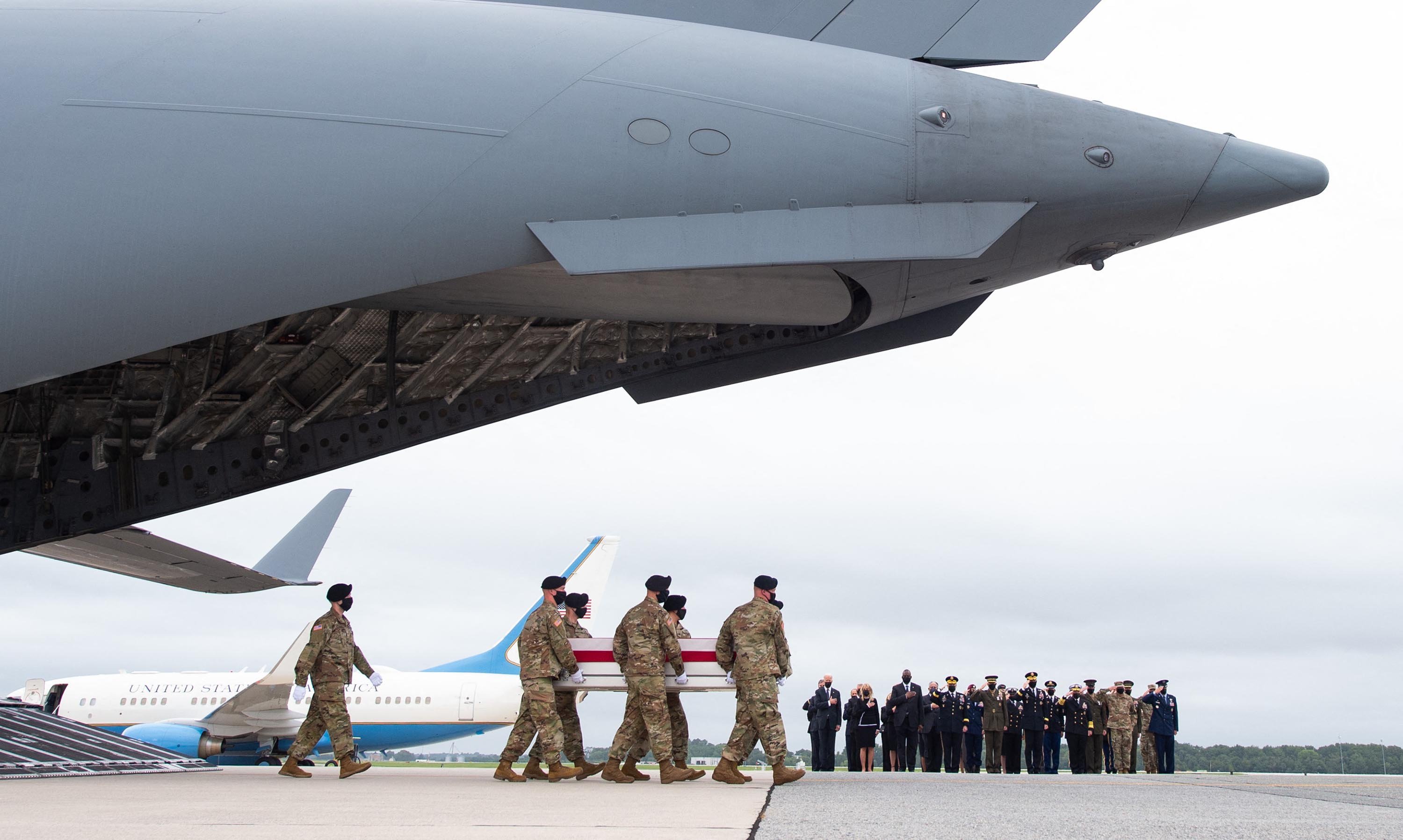 US President Joe Biden and other officials attend the dignified transfer of the remains offallen service members at Dover Air Force Base in Dover, Delaware, August, 29, after 13 members of the US military were killed in Afghanistan last week.