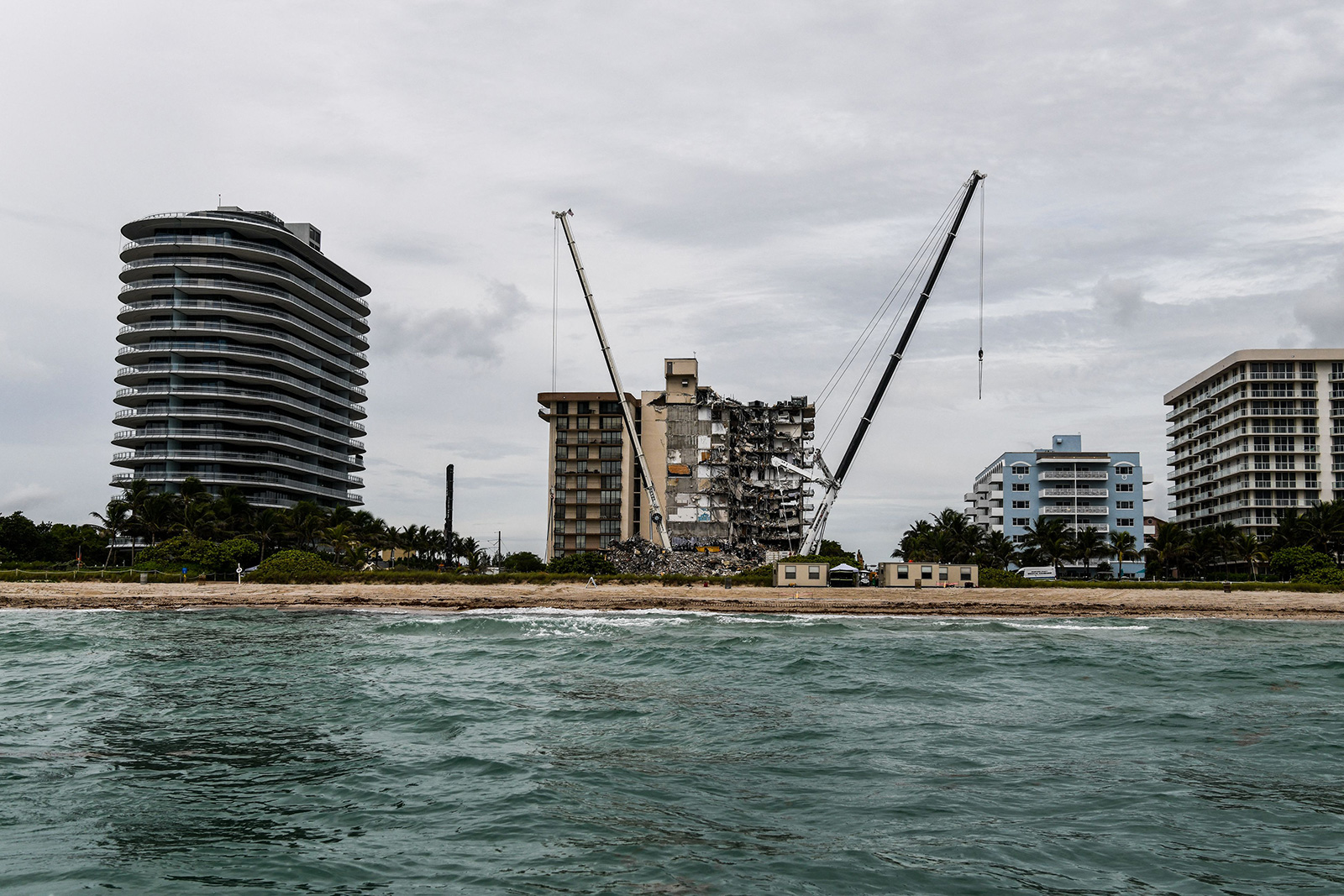 Search and Rescue teams look for possible survivors in the partially collapsed 12-story Champlain Towers South condo building on June 29, in Surfside, Florida.