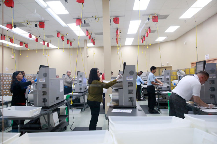 Workers counts ballots at the Broward County Supervisor Of Elections Office during the Florida Primary elections at the Broward County Supervisor Of Elections Office Tuesday, March 17.