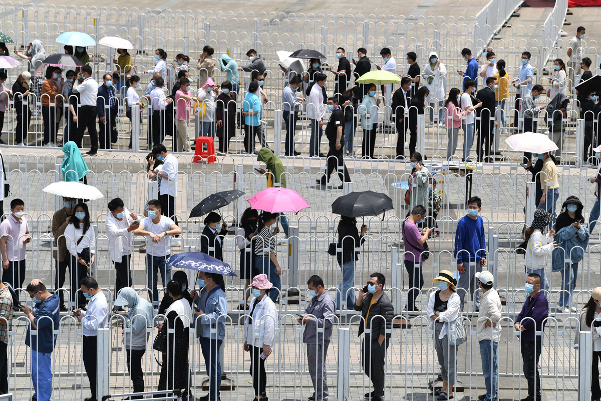 Residents queue to receive Covid-19 vaccines at Hefei Olympic Sports Center on May 17 in Anhui province, China.