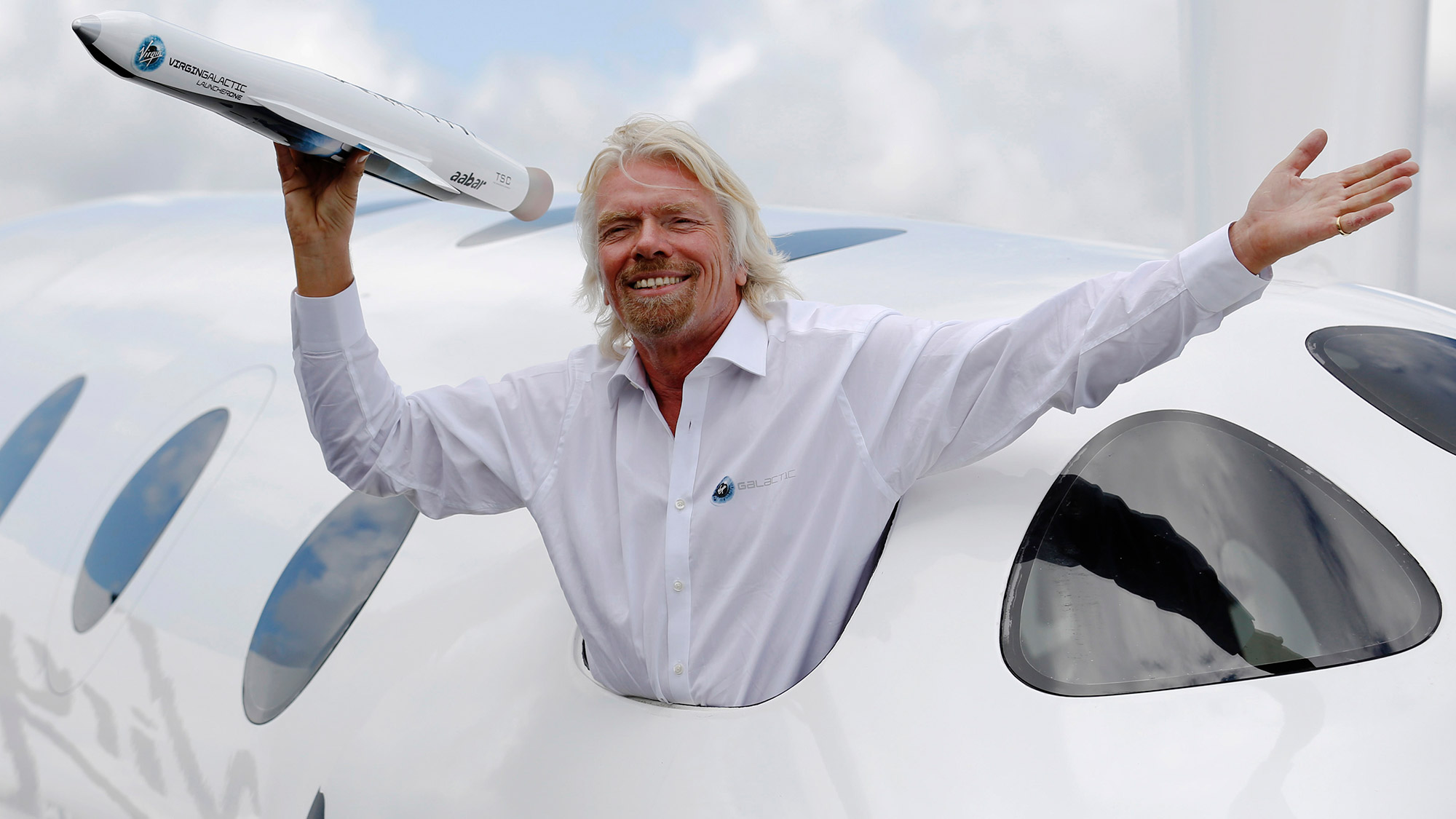 Richard Branson, seen here at an air show in 2012, is a self-made billionaire who has a large conglomerate of businesses under the Virgin brand.