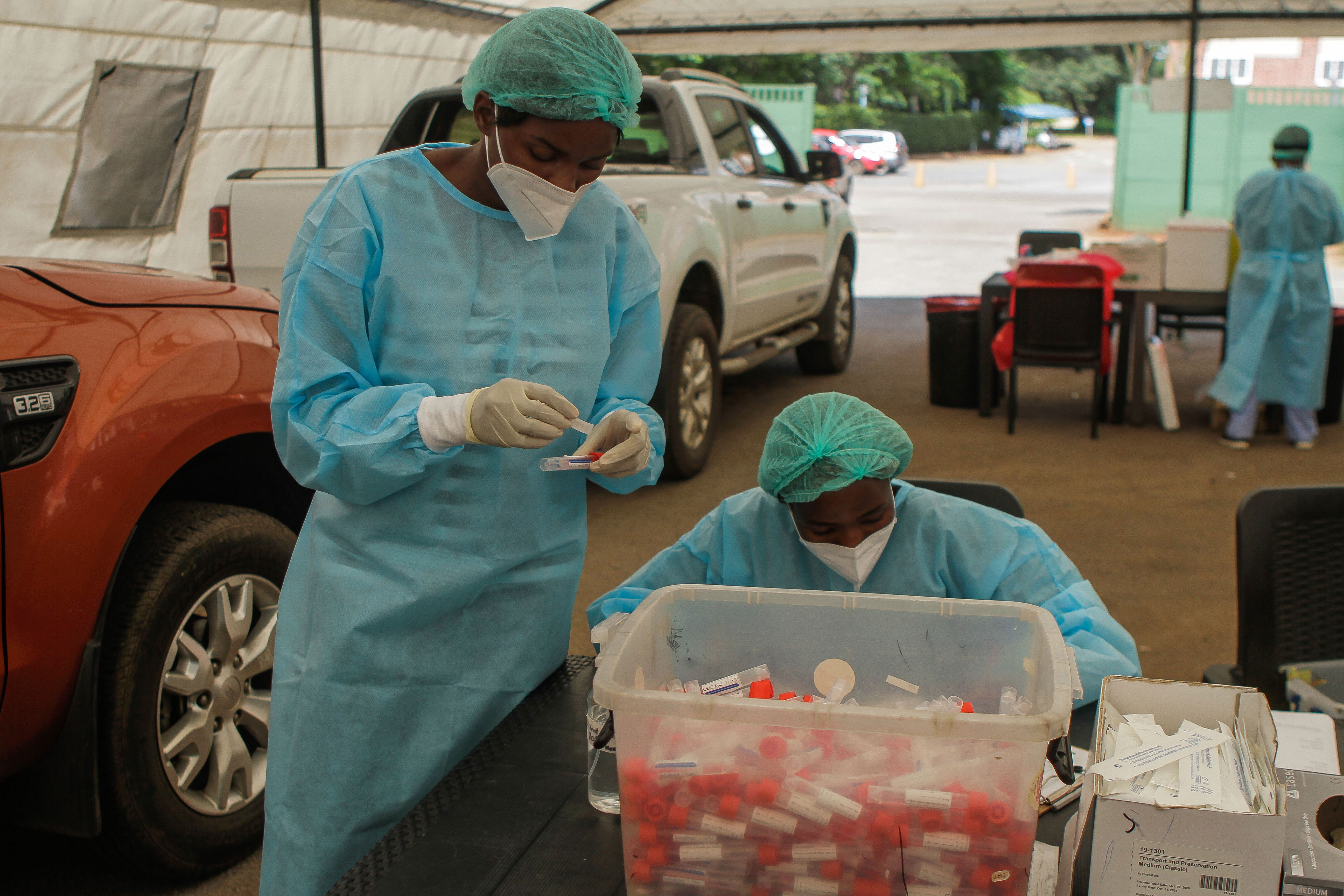 Lancet Clinical Laboratories employees in Harare, Zimbabwe, secure samples after conducting Covid-19 tests at a St Anne's Hospital drive thru facility on January 22.