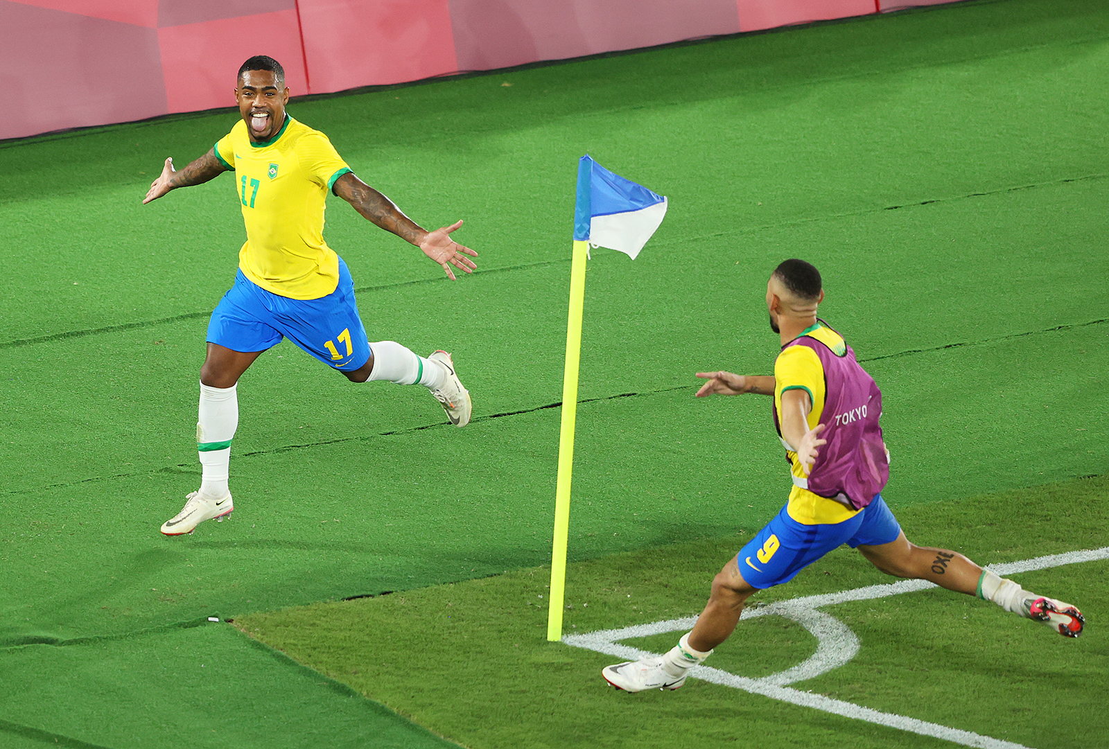 Malcom of Team Brazil celebrates after scoring Brazil's second goal during the men's gold medal match between Brazil and Spain on day fifteen of the Tokyo 2020 Olympic Games at International Stadium Yokohama on August 7, in Yokohama, Japan.