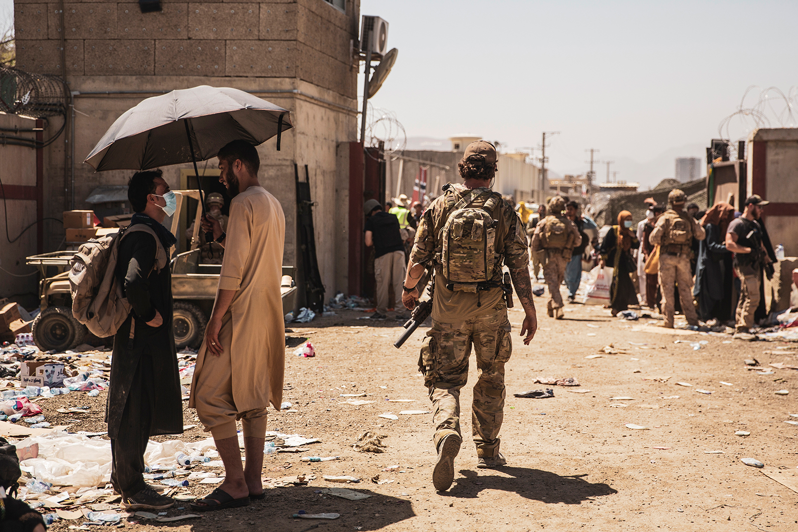 In this image provided by the U.S. Marine Corps, a Canadian coalition forces member walks through an evacuation control checkpoint during ongoing evacuations at Hamid Karzai International Airport in Kabul on Tuesday, August 24.