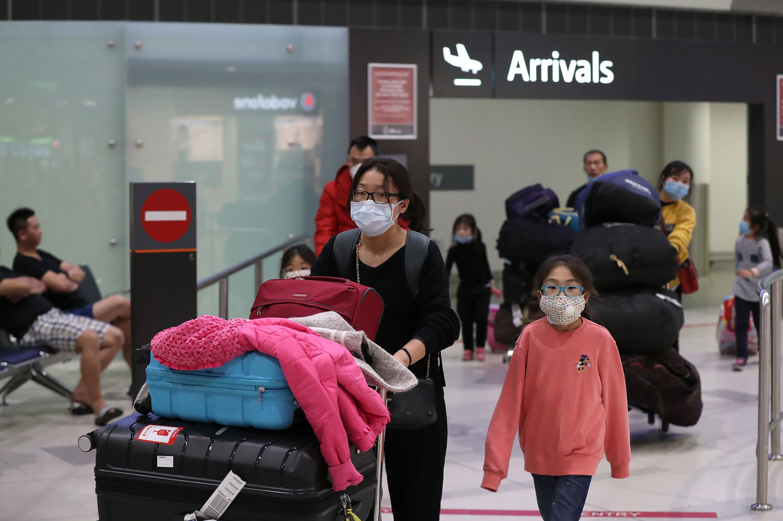 Passengers of a China Southern Airlines flight arrive at Perth International Airport in Australia on February 2