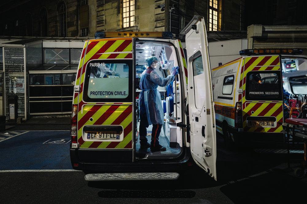 A French first aid worker disinfects an ambulance after it was used to transport a suspected coronavirus patient in Paris on April 3.