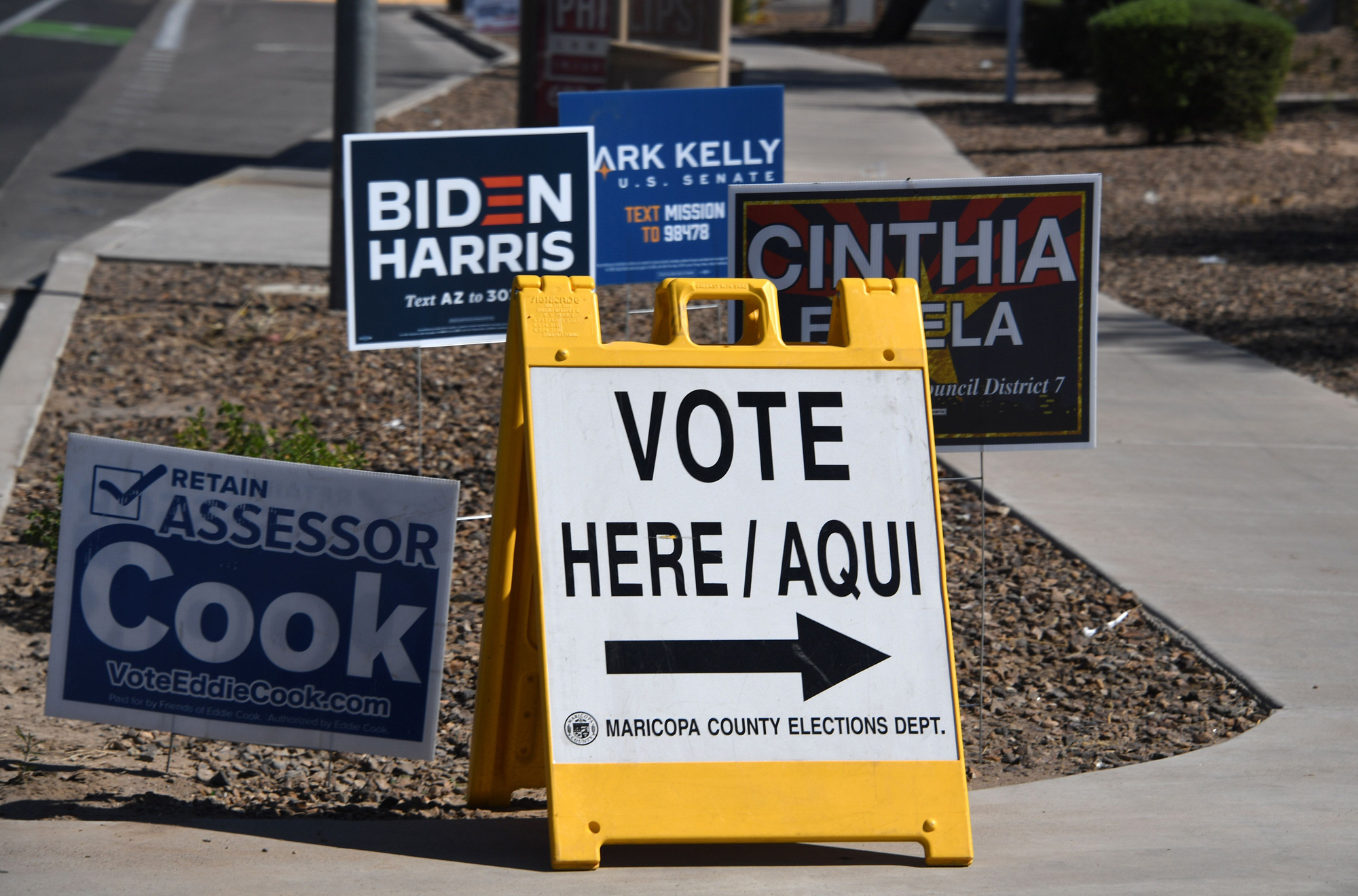 A sign points the way to an early voting location in Phoenix, Arizona, on October 16.