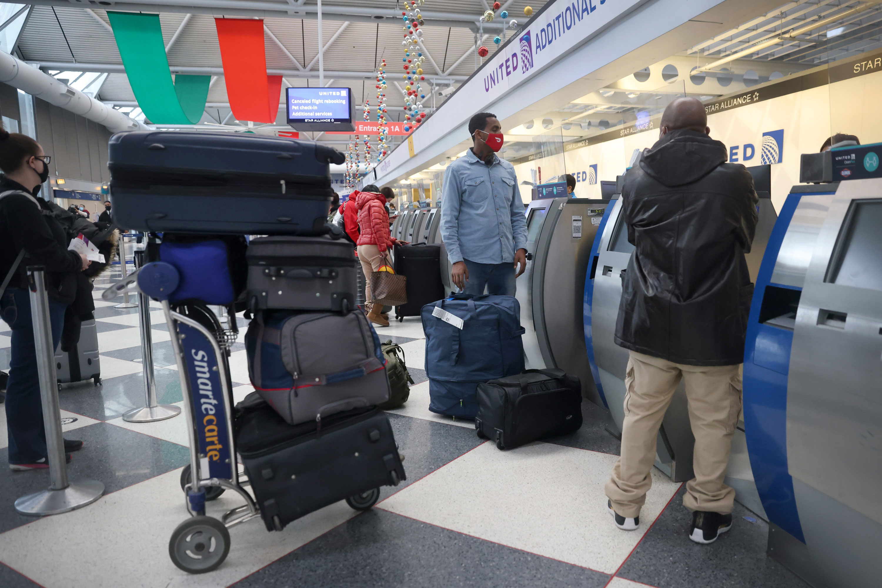 Travelers pass through O'Hare International Airport in Chicago on December 23.