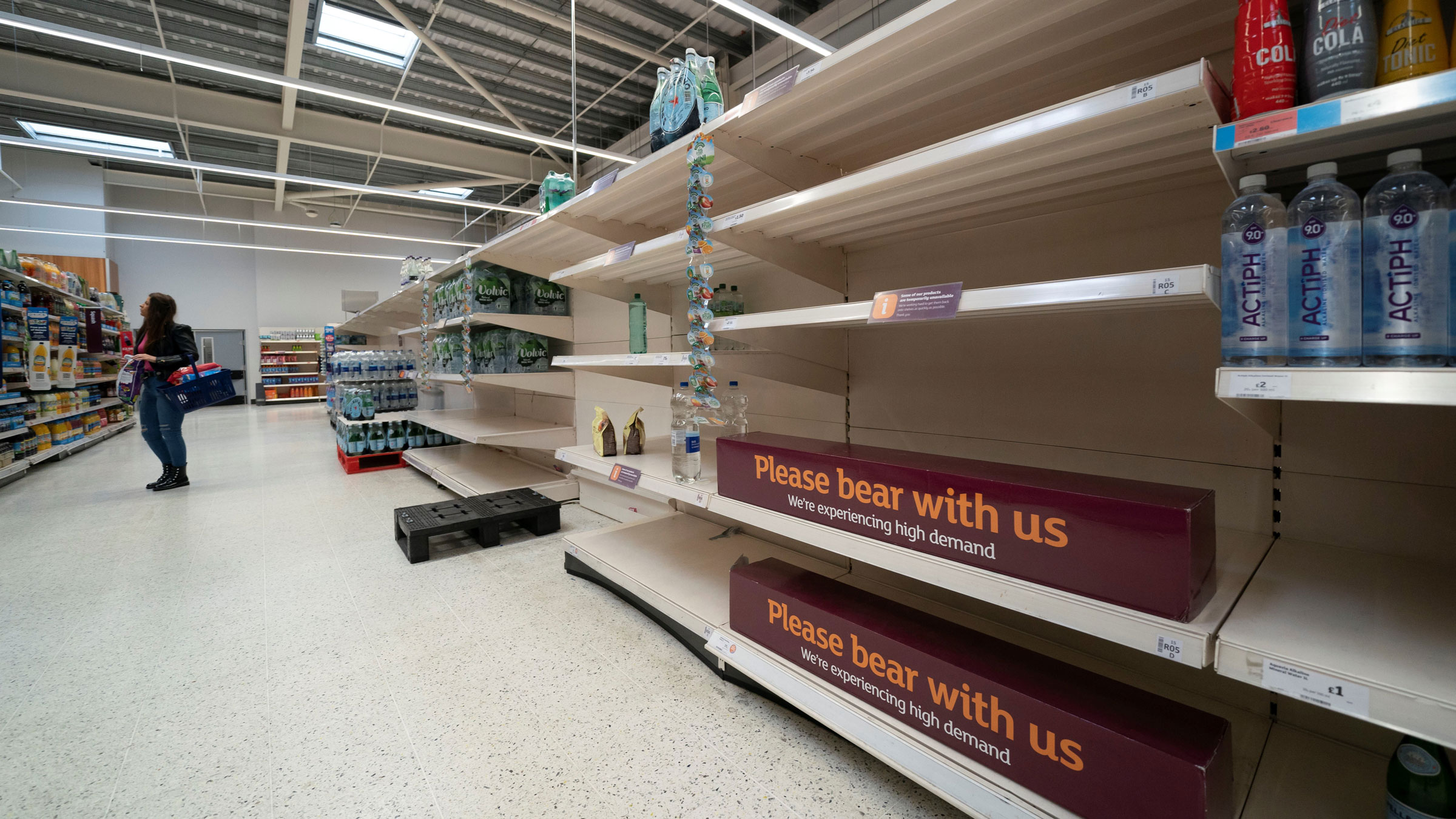 Empty shelves are seen at a supermarket in Manchester, England, on Wednesday.