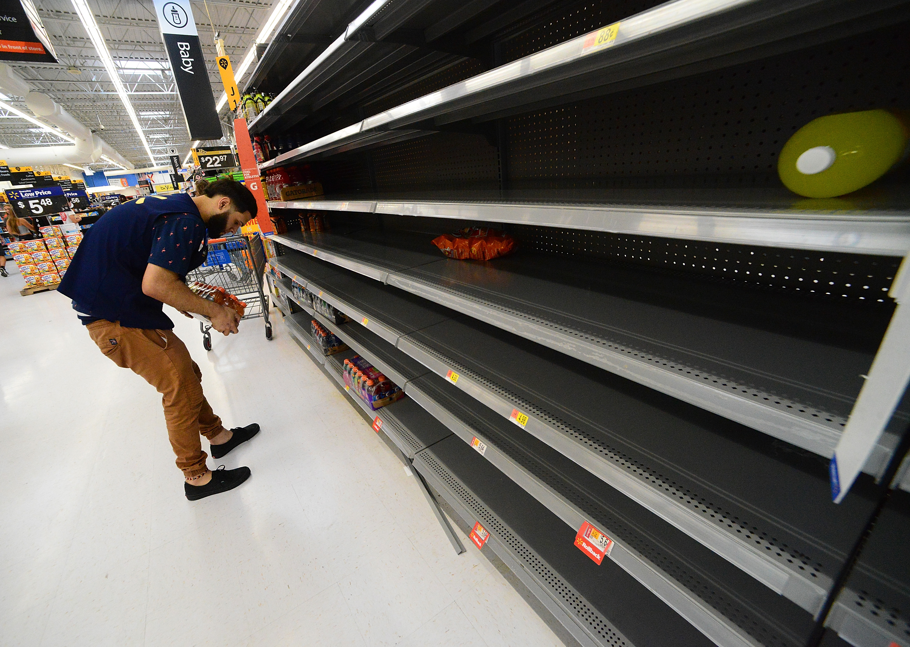 Florida residents have emptied shelves at Walmart on August 29, 2019 in Orlando as they prepare for Dorian.