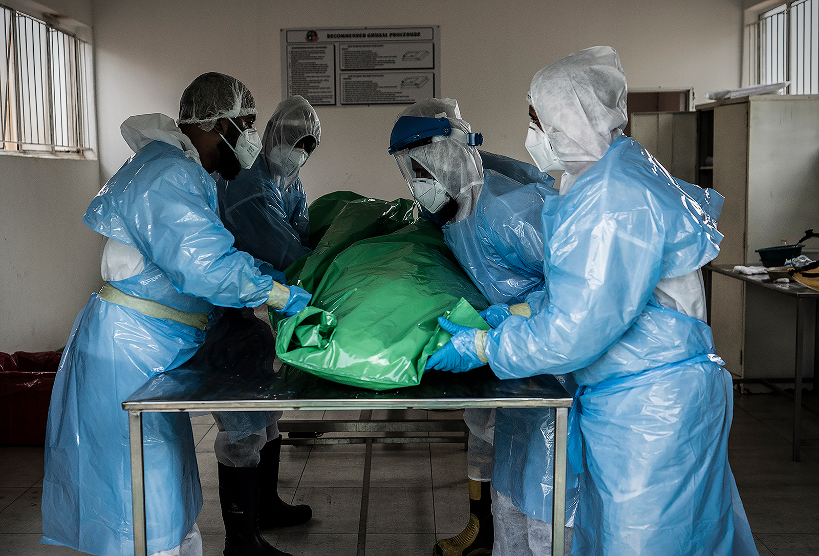 Members of the Saaberie Chishty Burial Society prepare the body of a person who died from Covid-19 in Johannesburg, South Africa, on December 26.