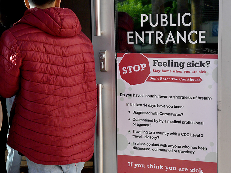A sign on a door at the Regional Justice Center in Las Vegas, instructs people not to come into the courthouse if they feel sick as the coronavirus continues to spread across the United States onMonday, March 16.