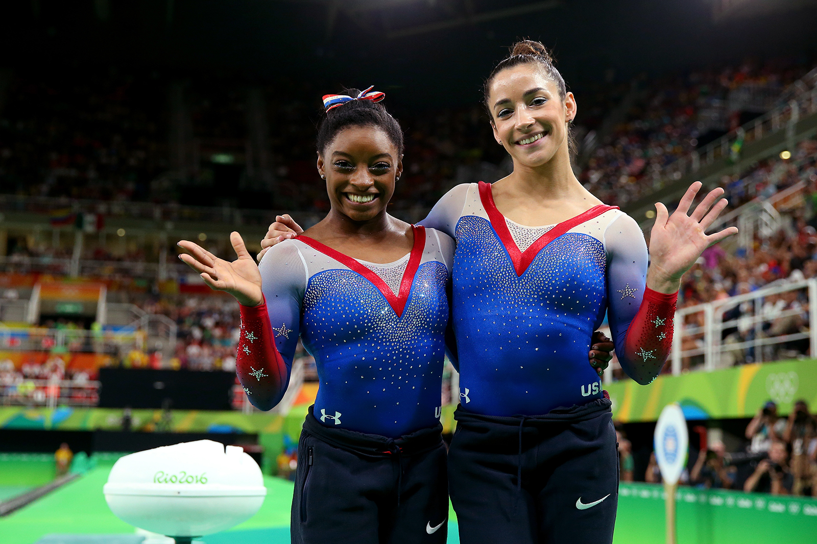 Simone Biles and Aly Raisman pose after winning the gold and silver medals respectively after competing on the Women's Floor Final on Day 11 of the Rio 2016 Olympic Games on August 16, 2016 in Rio de Janeiro, Brazil.