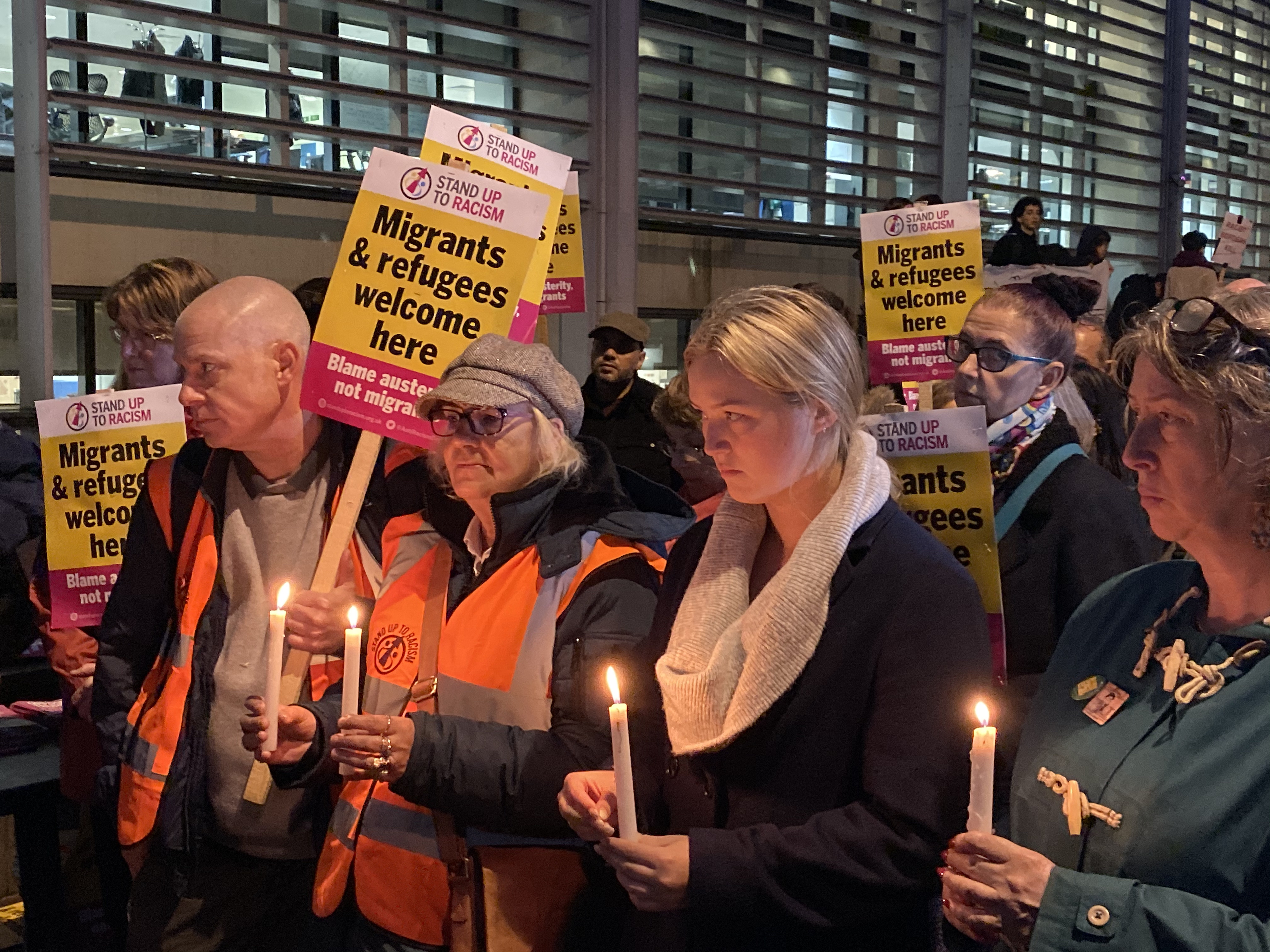 Mourners gather at the vigil outside the UK Home Office.