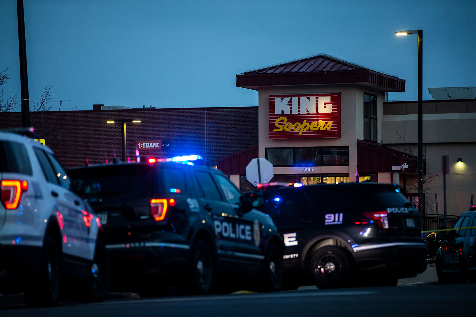 Police respond to the scene of a mass shooting at a King Soopers grocery store in Boulder, Colorado, on March 22.