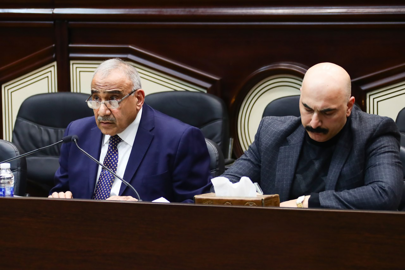 Iraqi Prime Minister Adil Abdul Mahdi (left) attends a parliament session in Baghdad, Iraq, on January 5.