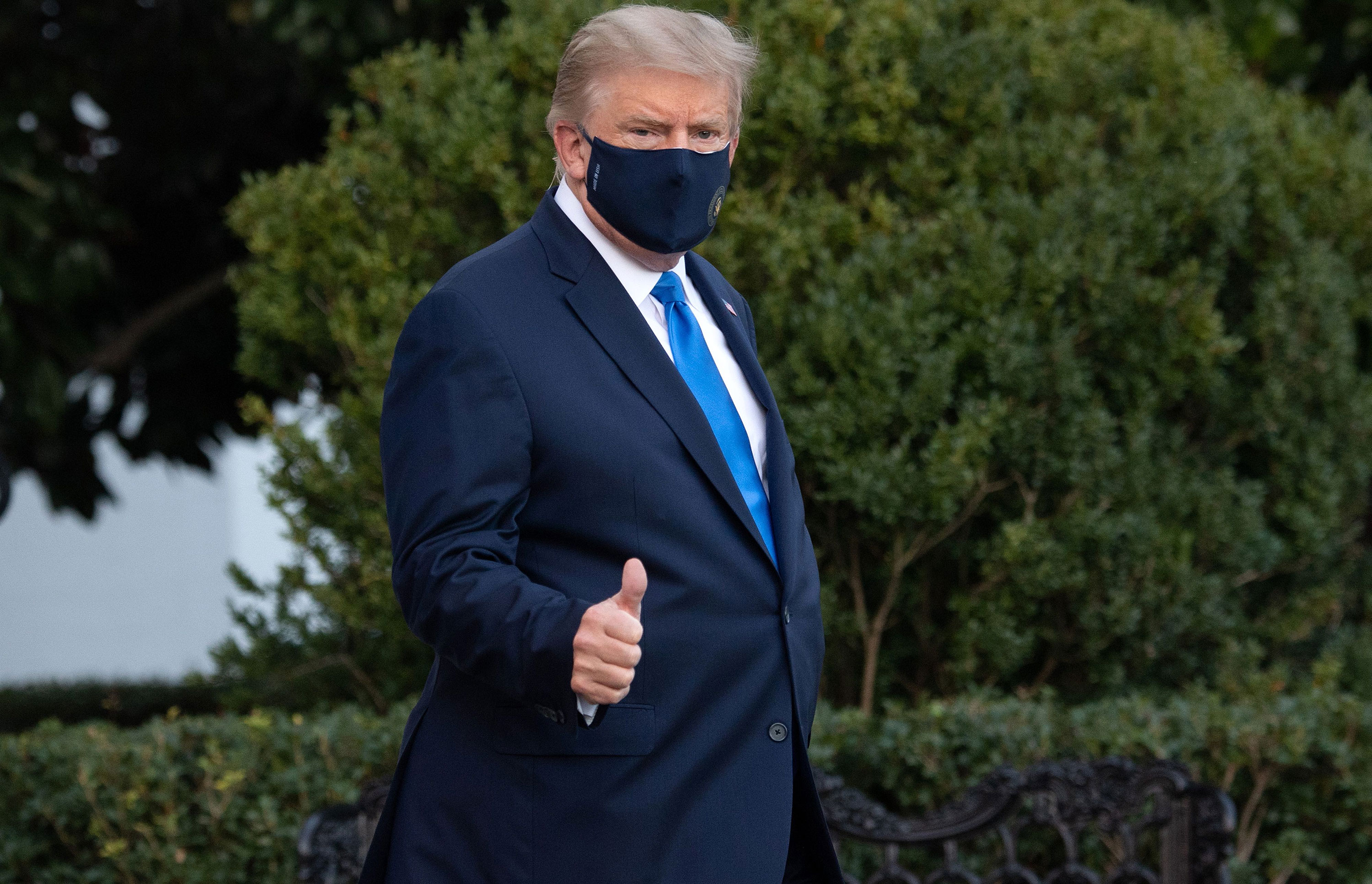 President Donald Trump gives a thumbs up as he walks to Marine One on the South Lawn of the White House as he heads to Walter Reed Military Medical Center on October 2.