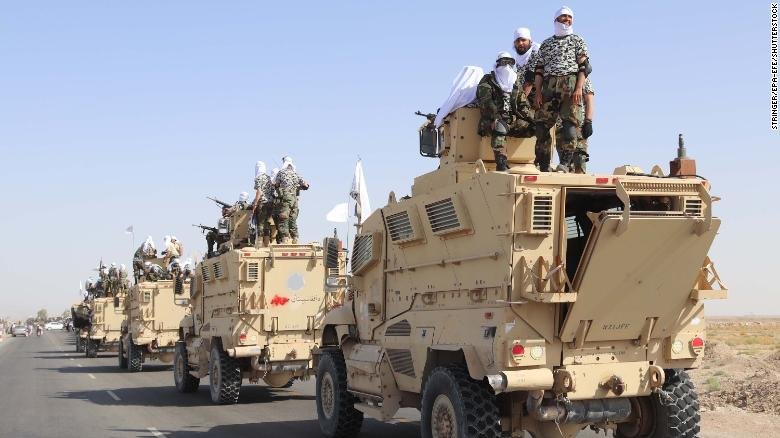 Taliban forces celebrate the withdrawal of US forces in Kandahar.