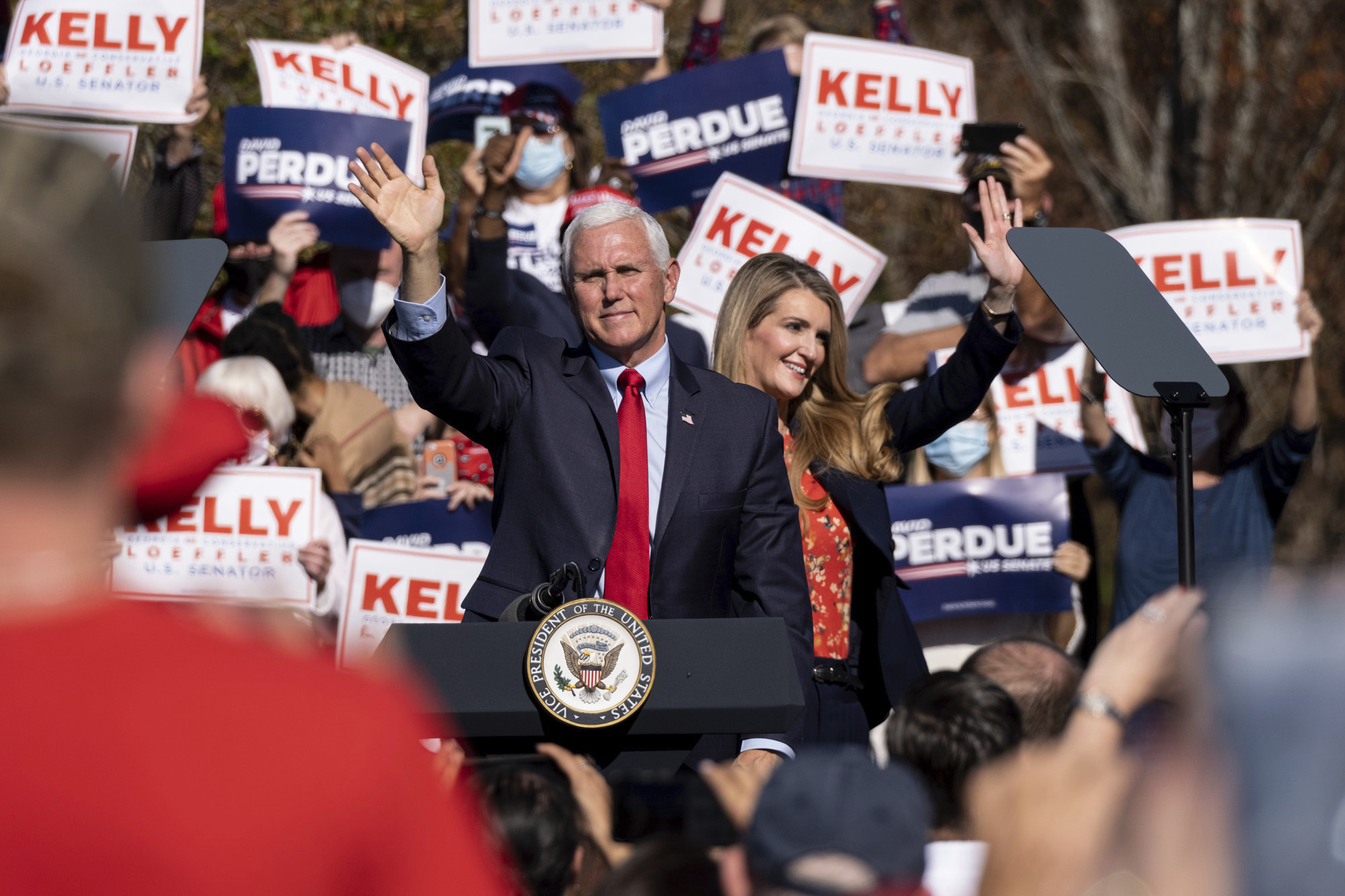 Vice President Mike Pence and Sen. Kelly Loeffler wave to the crowd during a campaign rally in Canton, Georgia, on November 20.