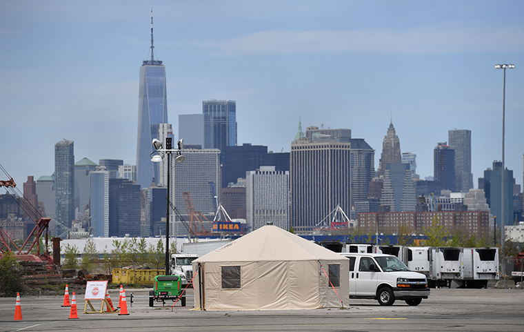 An F.D.N.Y. tent and refrigerated trucks serving as make shift morgues are seen on Tuesday, May 5, in the Brooklyn borough of New York City.