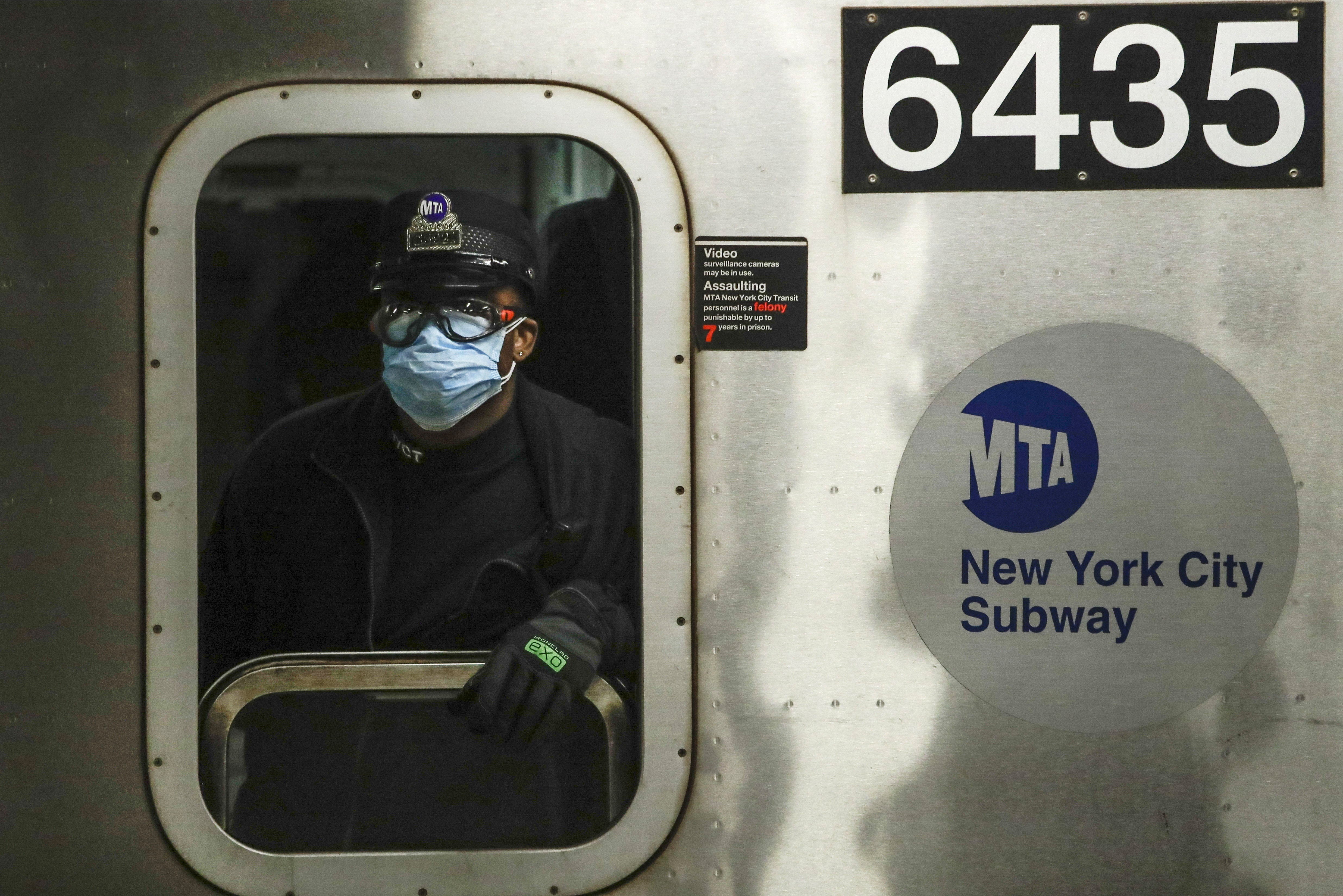 A Metropolitan Transportation Authority worker wears a face mask at the Grand Army Plaza station in Brooklyn, New York, on April 7.
