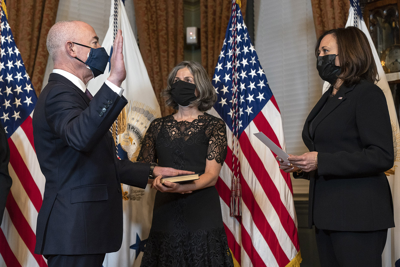 Vice President Kamala Harris swears in Alejandro Mayorkas as Secretary of the Department of Homeland Security, accompanied by his wife Tanya Mayorkas, on Tuesday, February 2, at the Eisenhower Executive Office Building on the White House Complex in Washington.