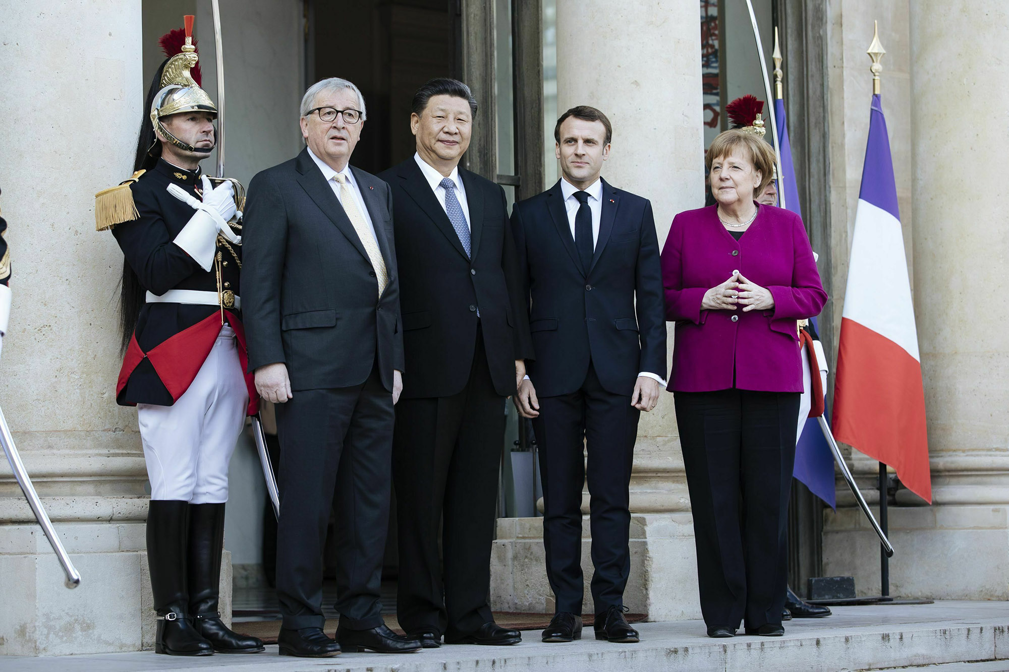 From left: European Union Commission President Jean-Claude Juncker, Chinese President Xi Jinping, French President Emmanuel Macron and German Chancellor Angela Merkel are pictured during a meeting at the Elysee Palace in Paris, France, in March 2019.