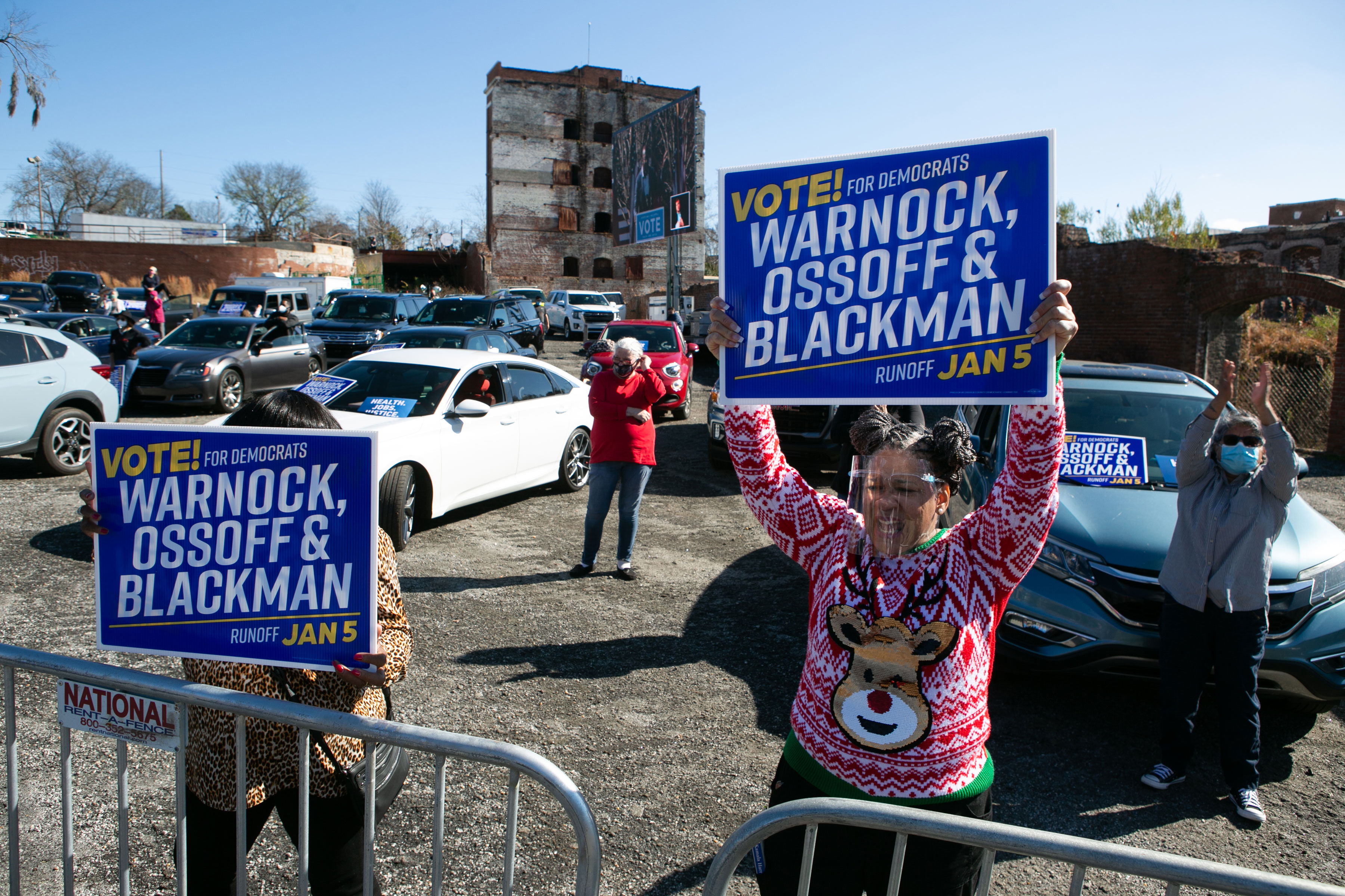 Supporters cheer for Vice President-elect Kamala Harris as she speaks in support of Georgia Democratic Senate candidates Rev. Raphael Warnock and Jon Ossoff during a drive-in rally on December 21, in Columbus, Georgia.