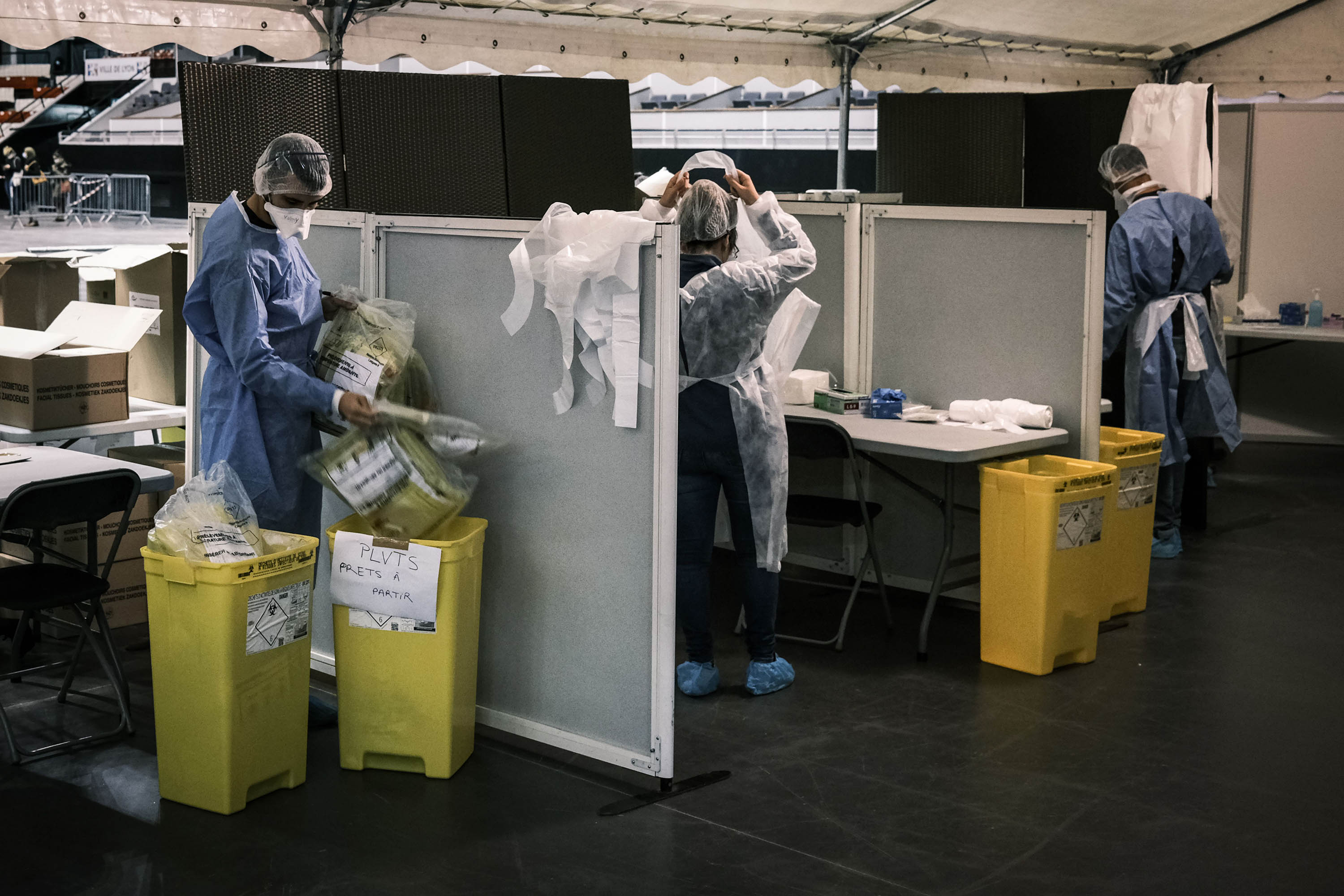 Medical personnel work on October 12 in a sports arena, which was converted into a screening center to test people for Covid-19, in Lyon, France.