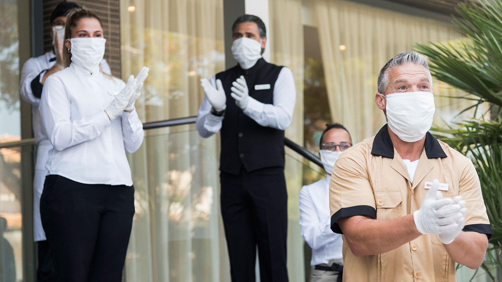 Workers of the RIU Hotel in Mallorca welcome guests from Germany on June 15.