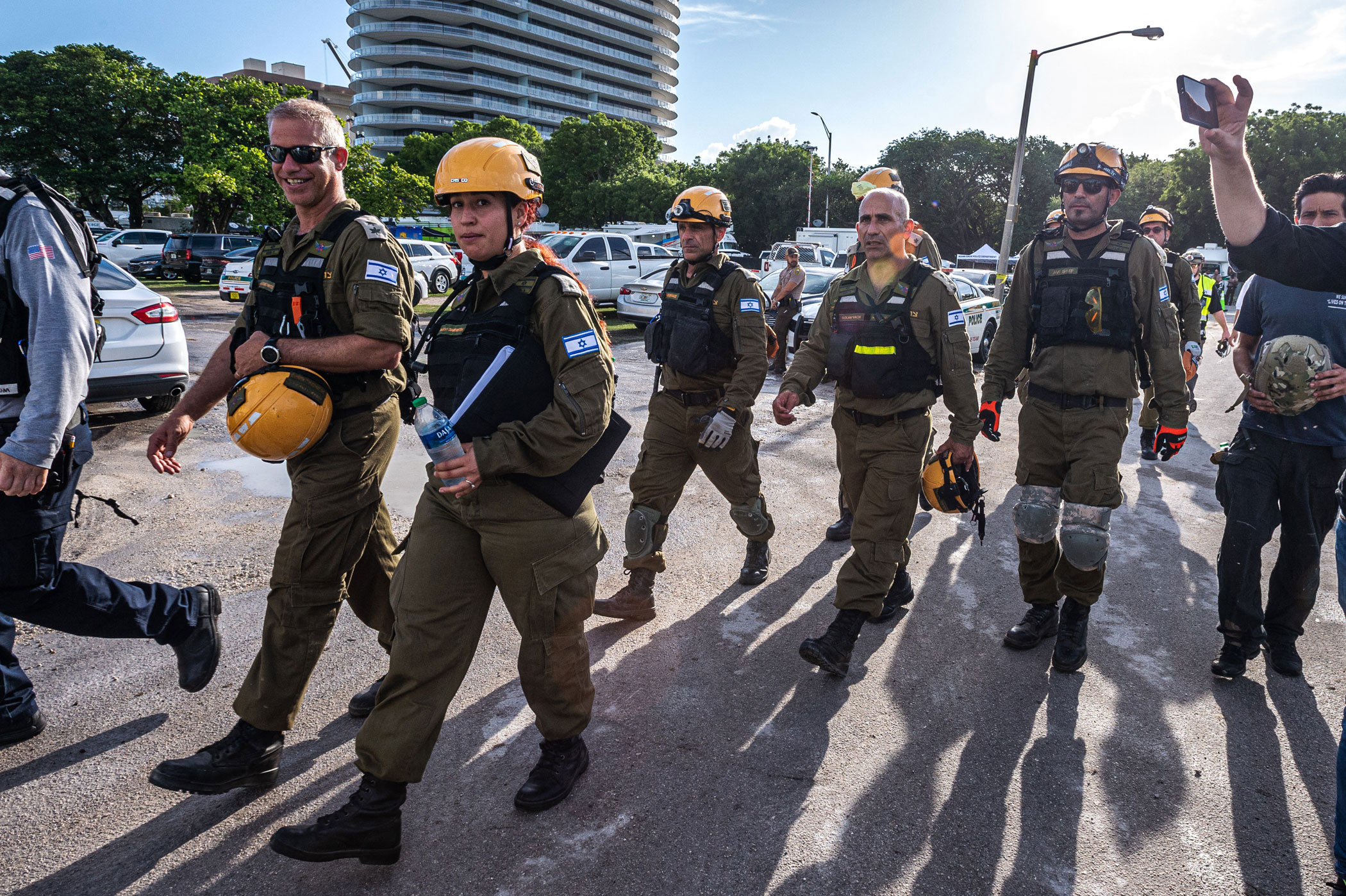 Members of the Israel Rescuers delegation gather upon their arrival in the area near the partially collapsed 12-story Champlain Towers South condo building in the city of Surfside, Florida, on Sunday, June 27.