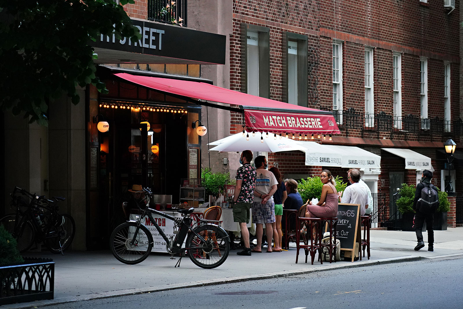 A restaurant serves drinks to customers outside on Saturday, June 20, as New York City prepares for phase two of reopening.