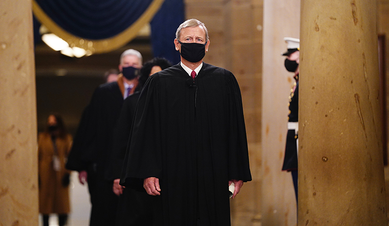 Chief Justice John Roberts leads the US Supreme Court Justices as they arrive in the Crypt of the US Capitol for President-elect Joe Biden's inauguration ceremony on Wednesday, Jan. 20, 2021 in Washington.