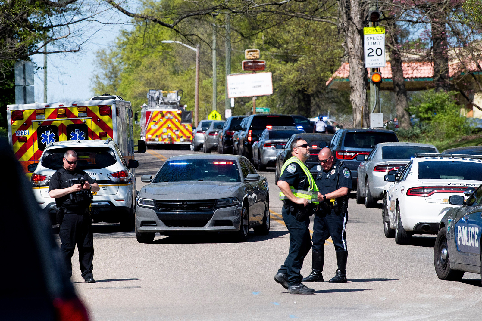 Police monitor the area near Austin-East High on Monday following a shooting.