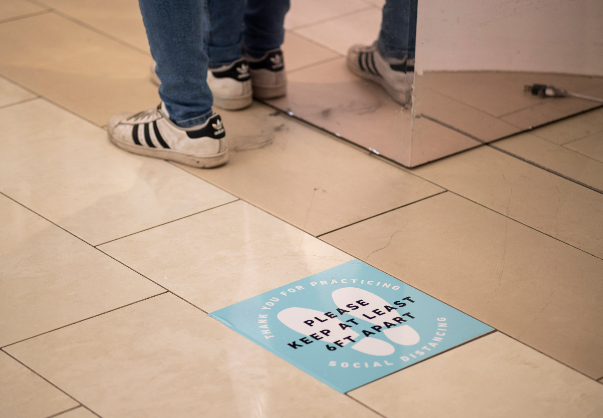 Signage asks people to socially distance outside a store inside the Mall of America before it opens on June 10 in Minneapolis.