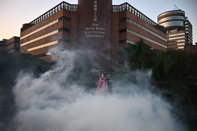 Police use tear gas outside the Hong Kong Polytechnic University on November 17, 2019.