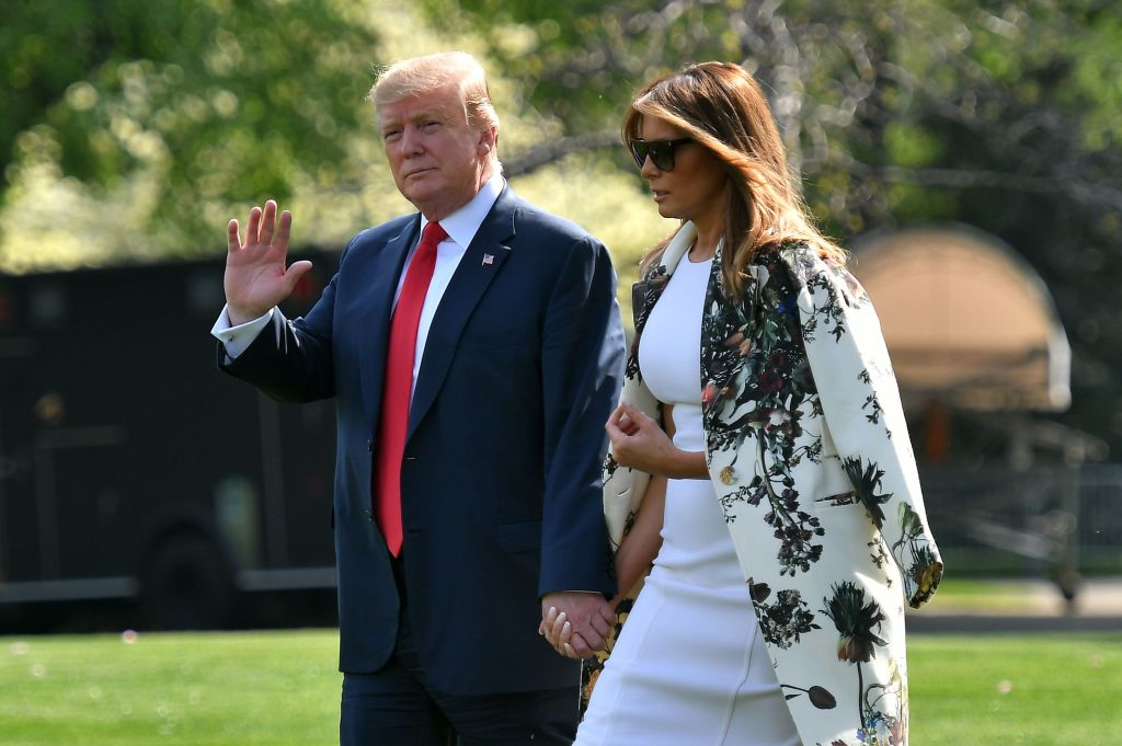 President Donald Trump and first lady Melania Trump walk together prior to boarding Marine One from the South Lawn of the White House in Washington, DC on April 18, 2019.